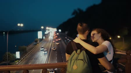 Couple on the bridge in the night .