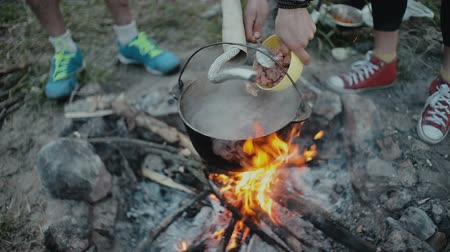 Cooking food on a campfire in forest.Camp life.Traveling.