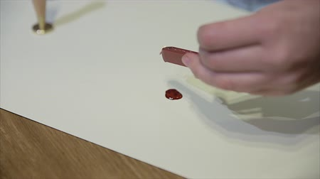 гарантия : Girl put a seal with a sealing wax.Red wax seal or signet isolated on white. Стоковые видеозаписи