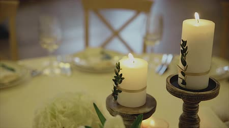 função : Interior of a wedding hall decoration ready for guests.Candles on table.Beautiful room for ceremonies and weddings.Wedding concept.Wedding decor.Sliding camera.