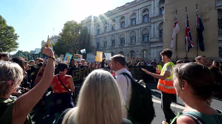 síremlék : LONDON - SEPTEMBER 20, 2019: Officials guiding an Extinction Rebellion march past The Cenotaph on Whitehall, London