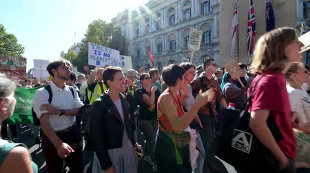síremlék : LONDON - SEPTEMBER 20, 2019: Extinction Rebellion protesters singing and waving placards in front of The Cenotaph on Whitehall, London