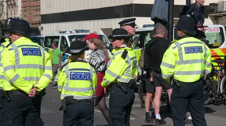law enforcement : LONDON - SEPTEMBER 20, 2019: Police Officers waiting for an Extinction Rebellion march to start in Parliament Square, London