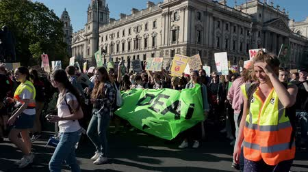 humanity : LONDON - SEPTEMBER 20, 2019: The end of an Extinction Rebellion march as it arrives back at Parliament Square, London