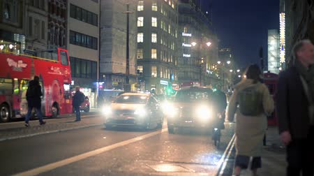 hackney carriage : LONDON - OCTOBER 23, 2019: Traffic on The Strand at night