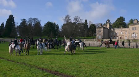 Aske Hall, Richmond, North Yorkshire, UK - February 08, 2020: Horse riders gathered in front of Aske Hall, ready for the start of a Fox Hunt