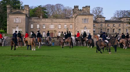Aske Hall, Richmond, North Yorkshire, UK - February 08, 2020: Horse riding fox hunters receiving pre-hunt briefing in front of traditional Georgian country house