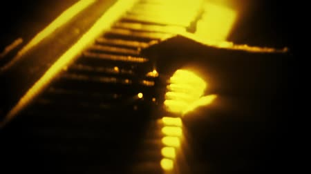 Man Playing a Gold Particles Piano - Hands Close Up - Motion Background