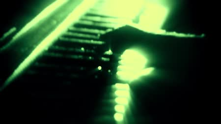 no hands : Man Playing a Green Particles Piano - Hands Close Up - Motion Background Stock Footage