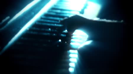 naladit : Man Playing a Blue Particles Piano - Hands Close Up - Motion Background
