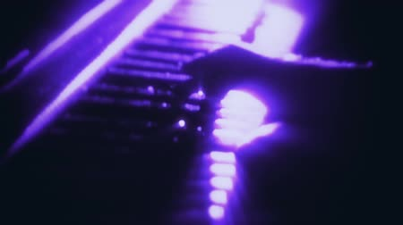 Man Playing a Purple Particles Piano - Hands Close Up - Motion Background Стоковые видеозаписи