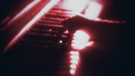 Man Playing a Red Particles Piano - Hands Close Up - Motion Background Стоковые видеозаписи