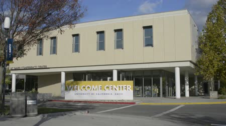 prospective : DAVIS CALIFORNIA, NOVEMBER 23 2016, The University of California, Davis Welcome Center and Conference Center building. Students and families exit the building and cross the street