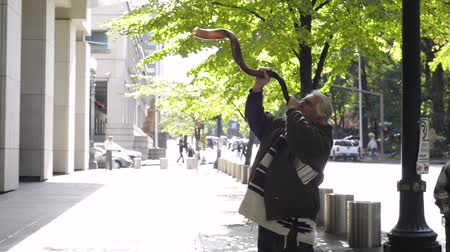 shofar : PORTLAND, OREGON OCTOBER 05 2016, Brand Nu Thornton blows his shofar in front of the courthouse in support of the defendants in the trial of the occupation of the Malheur National Wildlife Refuge.