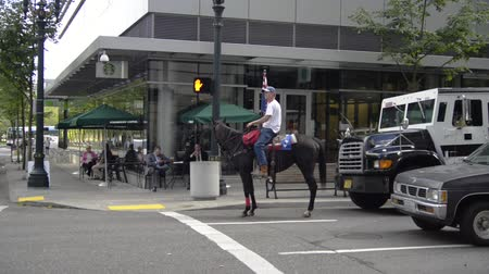 blm : PORTLAND, OREGON SEPTEMBER 27 2016, Protester of the trial of the armed occupation of the Malheur National Wildlife Refuge, near the federal courthouse riding his horse in traffic.