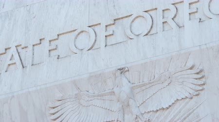 governor : Pan across the text State Of Oregon and an eagle, engraved into marble above the main entrance to the Capitol Building in Salem.
