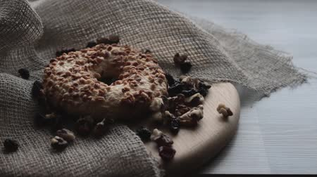 orzech : Cookie with nuts on wooden table. Raisins and walnut Wideo