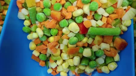 parsley : Frozen vegetables in the store. Carrot, green pea, corn, onion mix. Healthy and natural food. Stock Footage