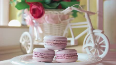 macarons : Pink french macarons, soft focus background. Sweet desert in the local cafe.