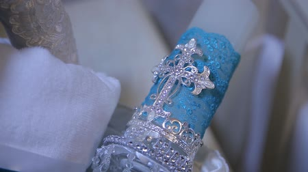 collectable : Decorative blue candle. White big decorative candle with holy cross. The figure of the cross on the candle. Selective focus Stock Footage