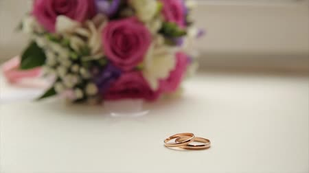 bearer : Wedding rings and rose. Wedding jewelry and rings. The Beauty Wedding Ring on a box. Golden wedding rings