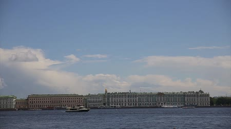 vasilevsky : View Winter Palace in Saint Petersburg from Neva river. Russia. Boat floats on Niva river past the winter Palace in Saint Petersburg. Hermitage Museum. Vasilevsky Island, And Frotress Stock Footage