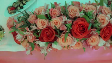 hall : Decoration of wedding table with flowers. wedding flowers on the table. Artificial roses decorate the wedding table. bouquets on the occasion. Celebration