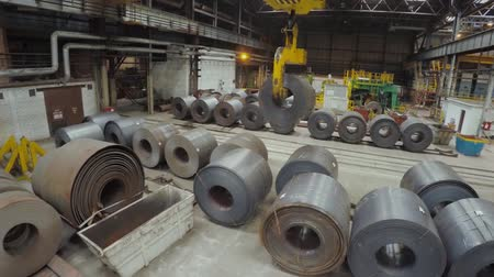 hangtompító : Old factory of auto components production. Warehouse of an aluminum pipes. the production of metal pipes. Pipe welding. Industrial zone, Steel pipelines and equipment. Metal pipes in a warehouse. Stack of steel pipe in factory Stock mozgókép