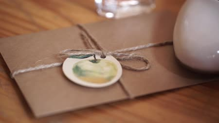 adresář : Vintage package tied up with string. Close up envelope sealed. Envelope of kraft paper tied with twine, with a red wax seal, close up.
