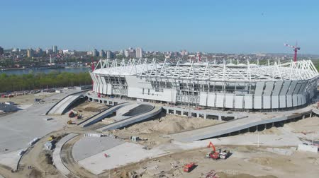 marco internacional : Aerial view on construction and reconstruction of football stadium. Reconstruction of stadium to host matches of world football championship in 2018. Russia. Construction company builds a stadium. Working Cranes