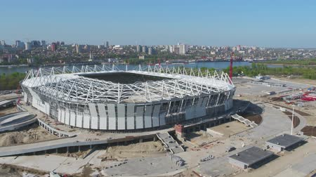 dach : Aerial view on construction and reconstruction of football stadium. Reconstruction of stadium to host matches of world football championship in 2018. Russia. Construction company builds a stadium. Working Cranes