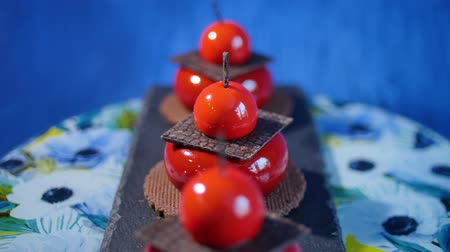 fatty acid : Three red cake with biscuits and chocolate. Tasty red cakes on background dark blue