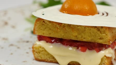 tarde : Victoria sponge cake with straberries, jam and whipped cream with a cut out piece on a white background