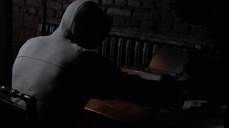 collectable : Young hooded male writer with typewriter. Hipster hooded man using a typewriter at work
