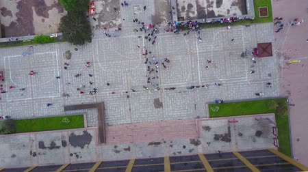 múltiplas : View from above city square. Aerial view two field basketball court with people