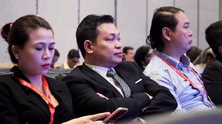 enterprise : DUBAI, UAE - OCTOBER 12, 2017: World blockchain, Business group Listening To Presentation At Conference. Businesspeople Listening to Presentation