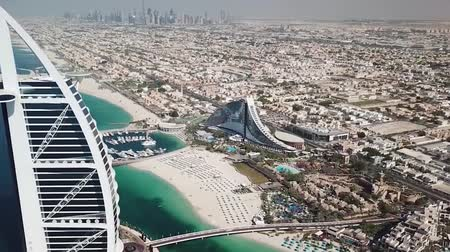 hotel suite : Dubai, UAE - May 25, 2018: Aerial view of Burj Al Arab luxury hotel on the coast of Persian Gulf on a clear sunny day. Stock. Dubai coastline from the air.