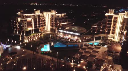 cape town : Belek, Turkey - July, 2018: Hotel complex for rich people. Clip. Top view of the luxury hotel by the sea at night