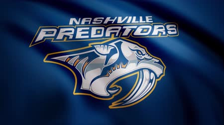 logotyp : Close-up of waving flag with Nashville Predators NHL hockey team logo, seamless loop. Editorial animation