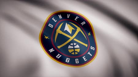 denver : Animation of flag with symbol of Basketball Denver Nuggets. Editorial animation