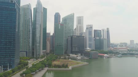 SINGAPORE - June, 2018: The Marina Bay Financial Centre in Singapore. Shot. It is consisting of three office towers, two residential towers and retail space at Marina Bay Link Mall. Top view of the financial center of Singapore with skyscrapers