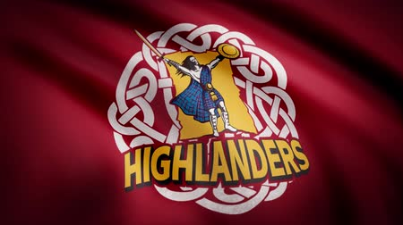 rúgbi : Waving in the wind flag with the symbol of the Rugby team the Highlanders. Sports concept. Editorial use only