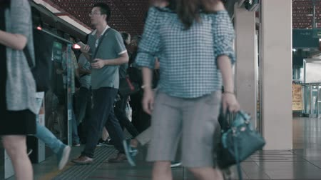 rapid transit : SINGAPORE - JUNE 11, 2018: Time lapse train station subway station platform with people waiting for train in Singapore city. Shot