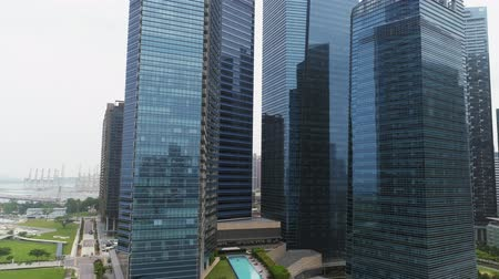 skypark : SINGAPORE, JUNE 2018: Aerial footage of Singapore skyscrapers with City Skyline during cloudy summer day. Shot. Singapore New city buildings Skyscrapers Aerial view