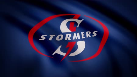 oválný : Waving in the wind flag with the symbol of the Rugby team the Stormers. Sports concept. Editorial use only Dostupné videozáznamy