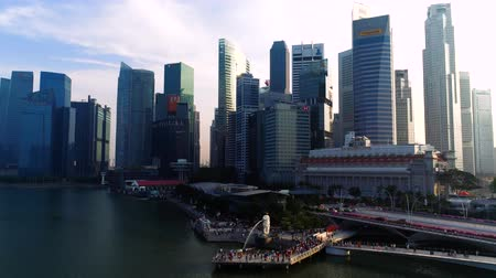 Singapore - August, 2018: View of central Singapore. Shot. Merlion lion fountain sculpture and financial towers on background