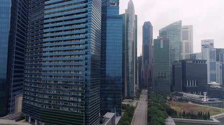Singapore - August, 2018: Top view of panoramic scene of day of majestic cityscape with modern new buildings. Shot. Modern futuristic buildings architecture. Top view of megapolis skyscrapers with mirror blue facade in afternoon Stok Video