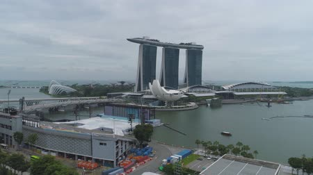 Singapore - 25 September 2018: Aerial for the famous Marina Bay Sands hotel in Singapore near the river. Shot. Unusual Art and Science Museum near the river and stunning hotel Marina Bay Sands.
