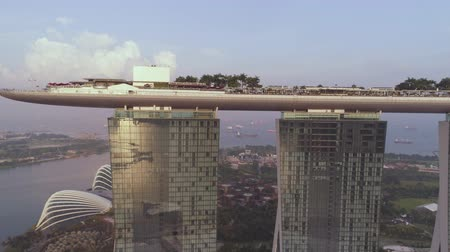 Singapore - 25 September 2018: Side view of Marina Bay Sands hotel with amazing gondola on the roof. Shot. Marina Bay Sands on sky and rver background, Singapore.