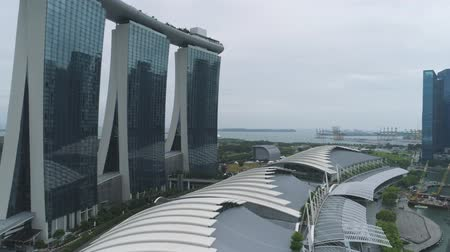 Singapore - 25 September 2018: Close up for Marina Bay Sands Resort with glace facade in Singapore. Shot. Close up for beautiful hotel with gondola on the roof in Singapore at daytime.